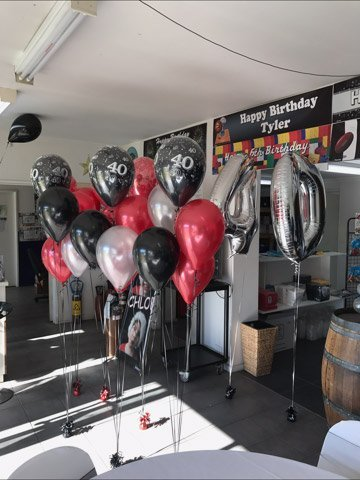 red and black birthday ballons