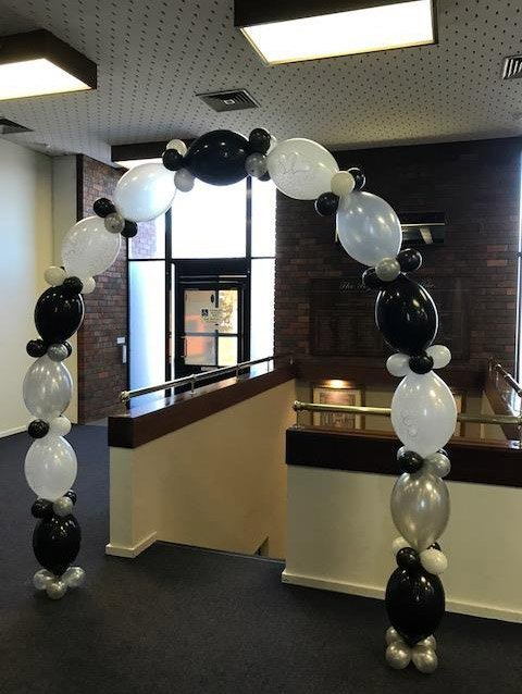 black and white engagement balloon archway