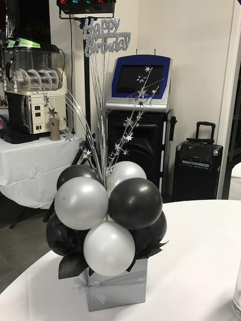 silver and white balloon arrangement