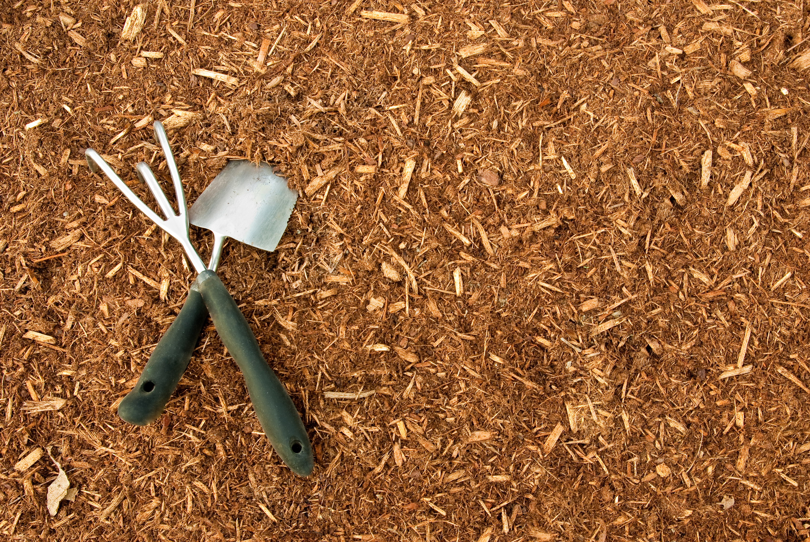 Wood chips with a rake and shovel