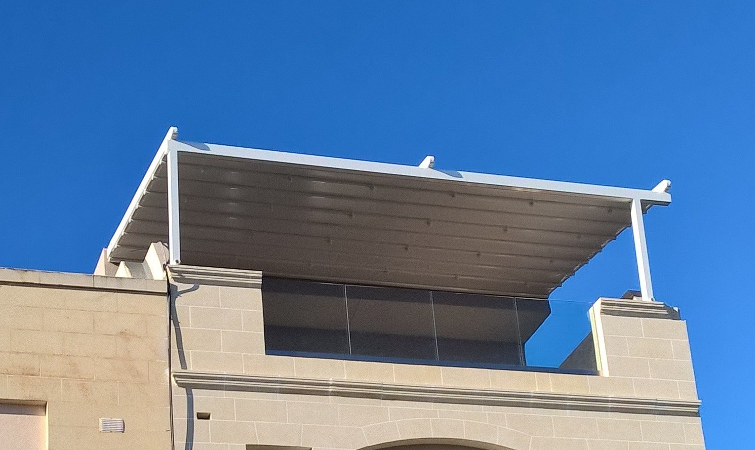 Rooftop Pergola with Glass railings with stunning views across Malta & Rooftop Pergola Installation