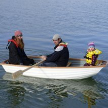 family sailing in dinghies