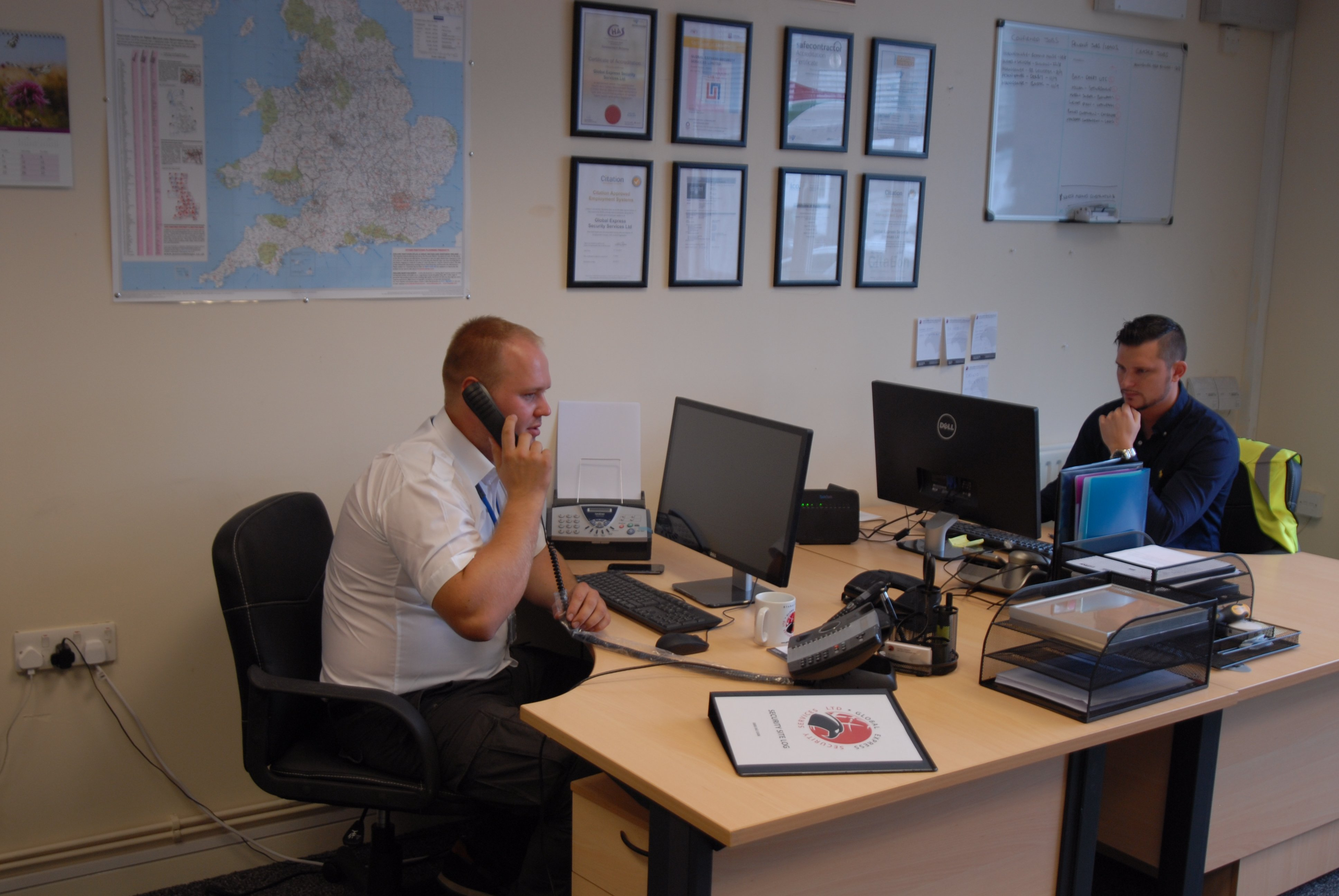 Man speaking to a customer at Global Express Security Services Ltd
