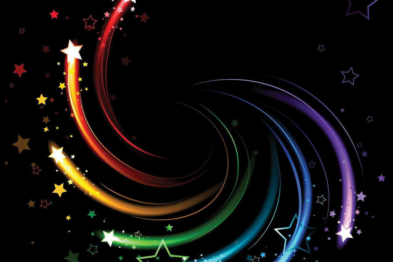 Glowing sparks of all colors of the rainbow twist on a black background