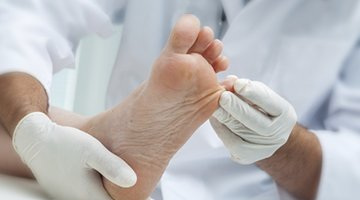 Podiatrist in Wollongong examining a patient's foot