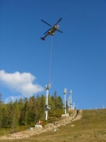 Helicopter-assisted tower positioning