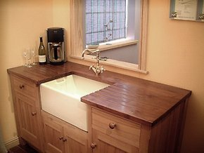 Traditional wooden cabinets with white sink