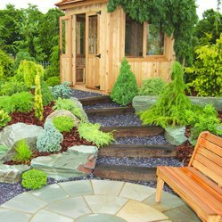 Patio with steps leading to summer house