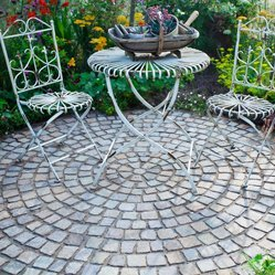 Circular stone patio with bistro set