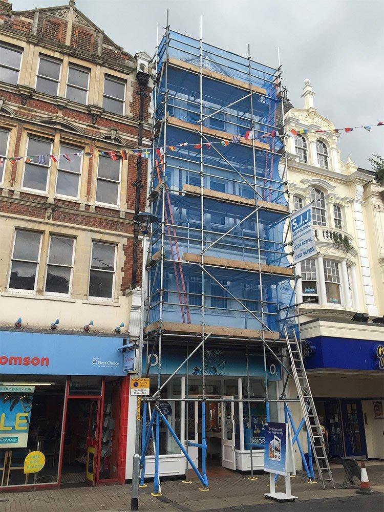 sjj scaffolding blue textile covering scaffolds