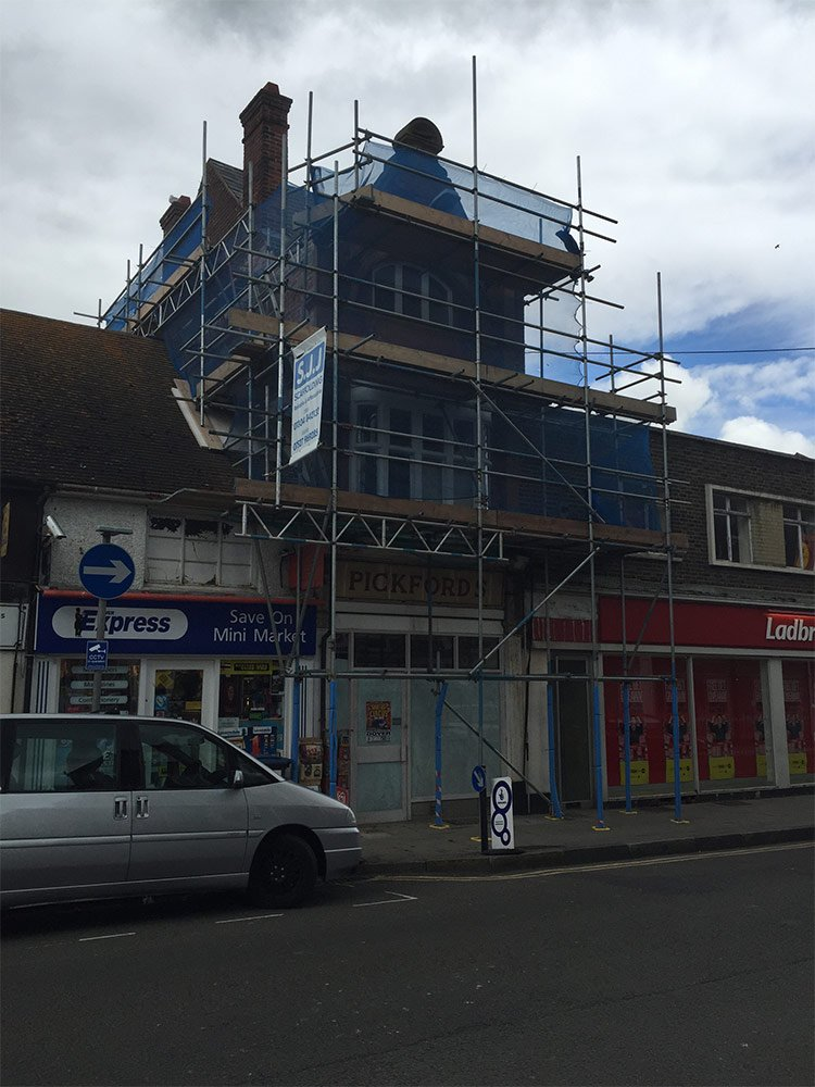 sjj scaffolding partially covering a house