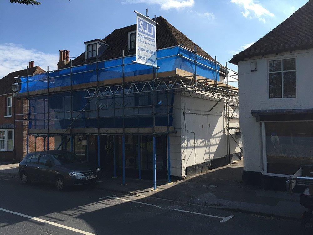 sjj scaffolding banner in the sun
