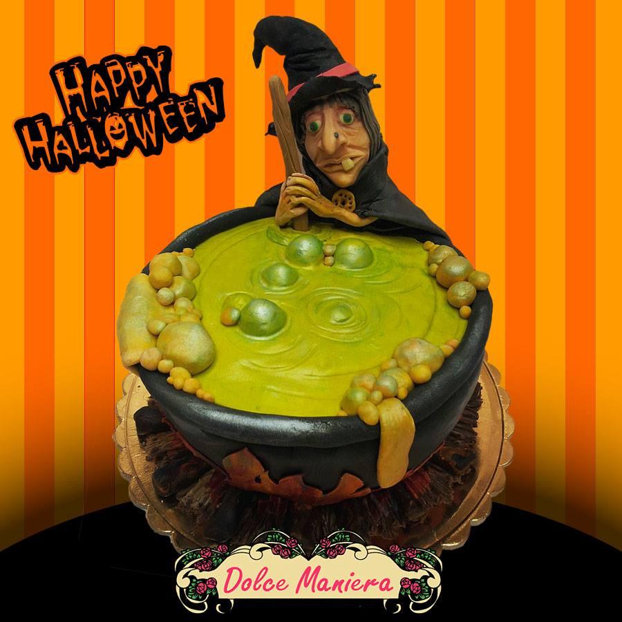 Decorazione di halloween con strega e calderone