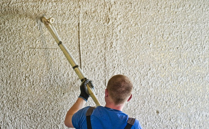 Professional applying concrete stucco to wall in Kingman, AZ