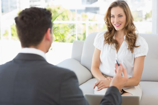smiling woman meeting with an advisor