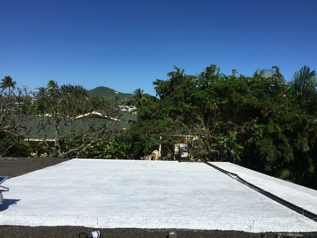 Roof coating on a roof of a residential property