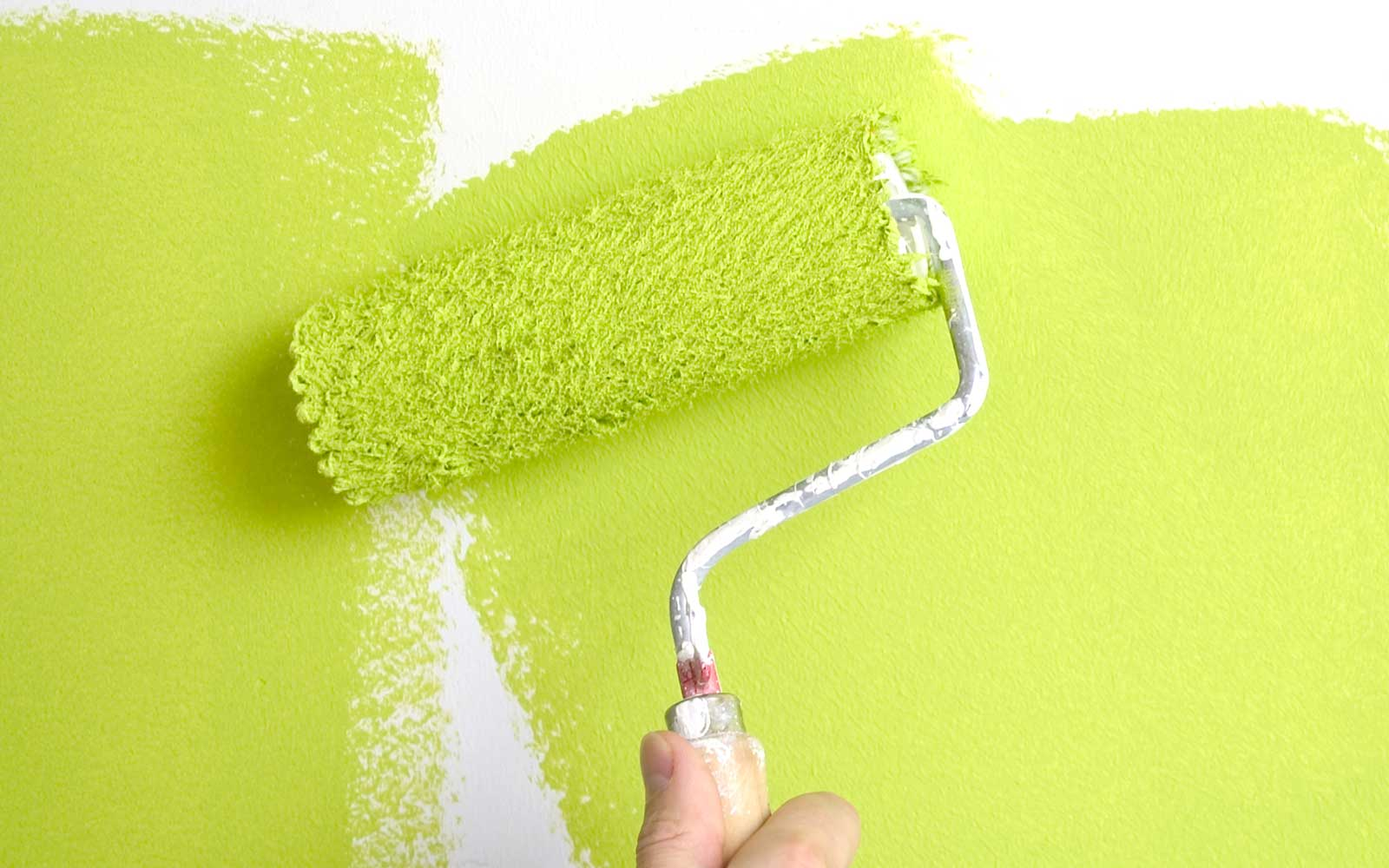 painting a wall with a roll