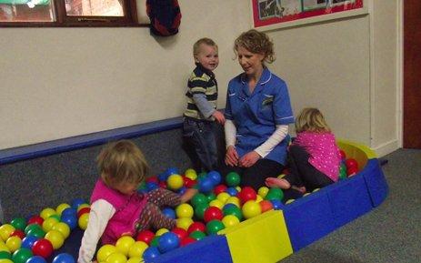 children in ball area