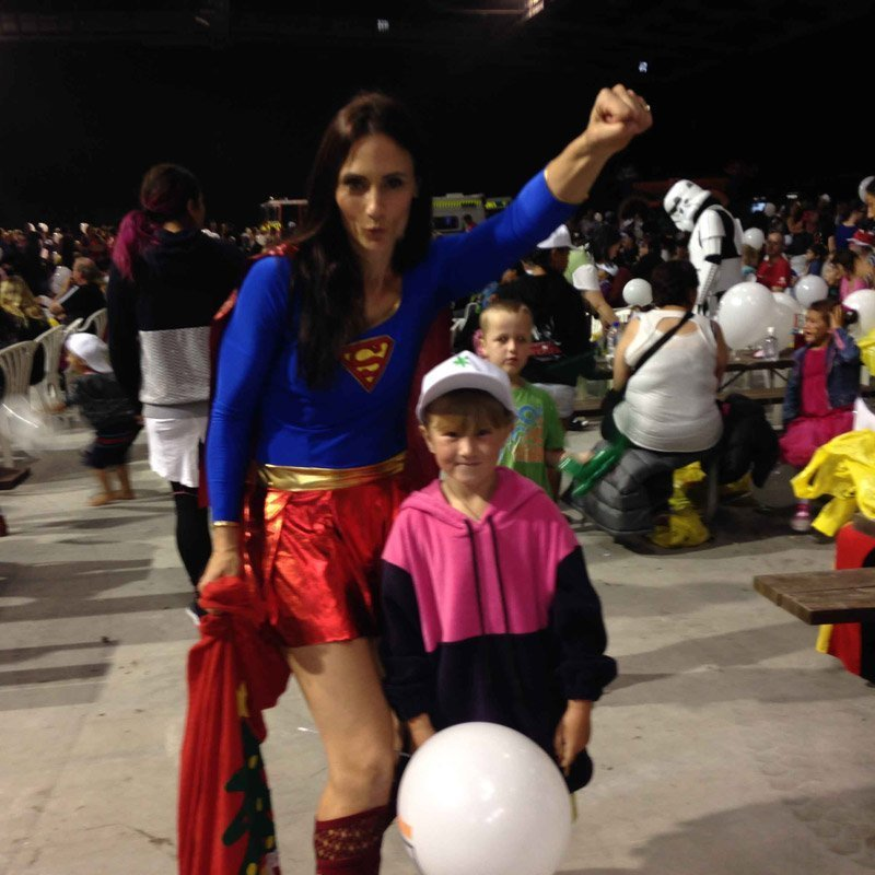 Mother with her child in superman costume
