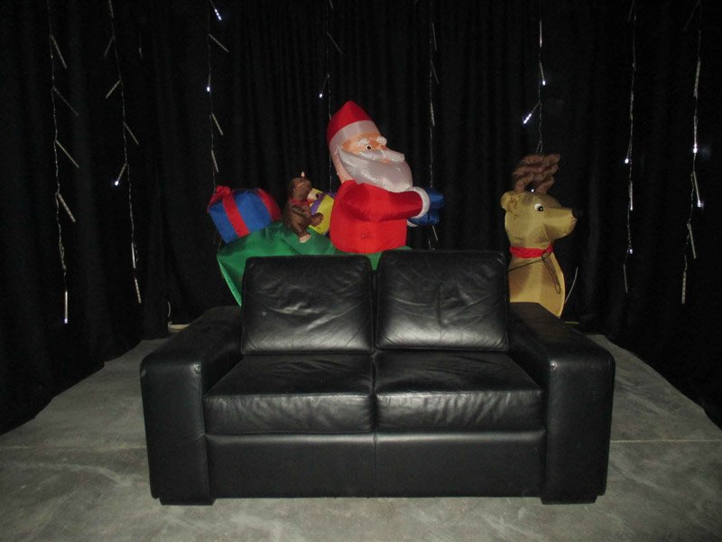 Santa posing with sofa