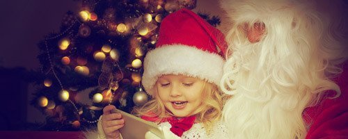 Child happy with Santa gift