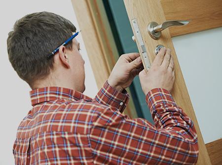 Professional repairing the door lock in Dothan, AL