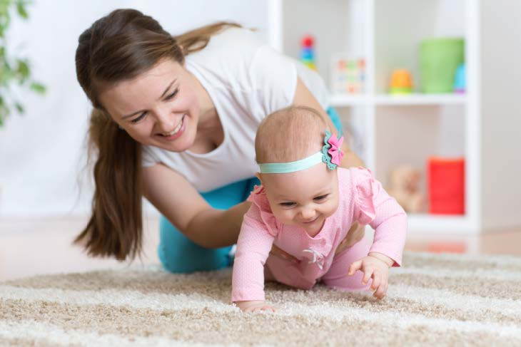 Baby strolling on the steam cleaned carpet