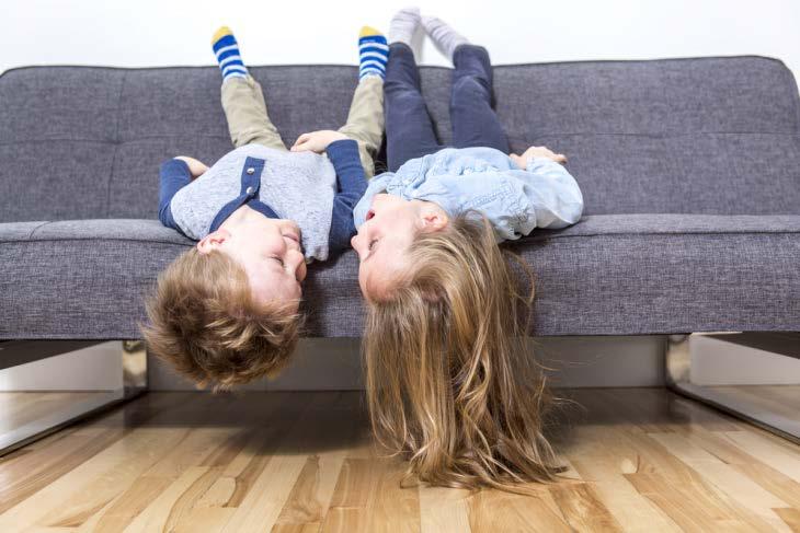 Children having fun on the sofa