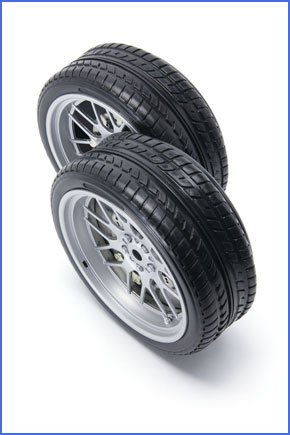 Two new black car tyres