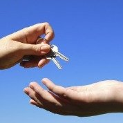 Professional handing over the keys to the customer
