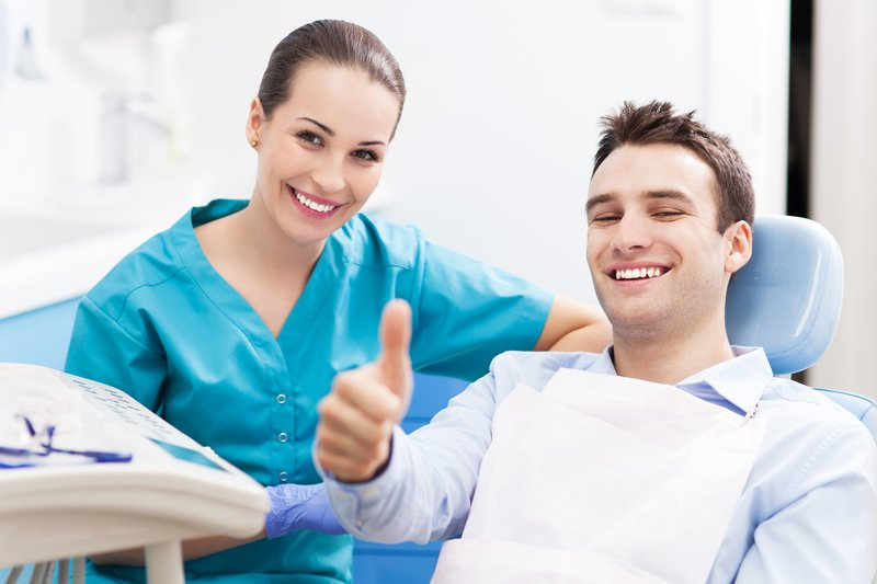 Dentist and patient working on patients good oral hygiene in Texarkana, TX