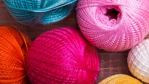 Assorted colors of balls of yarn