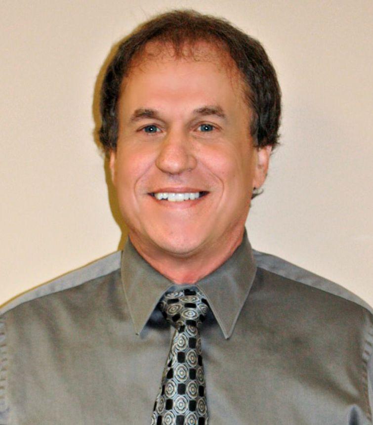 Dr. Michael E. Nell