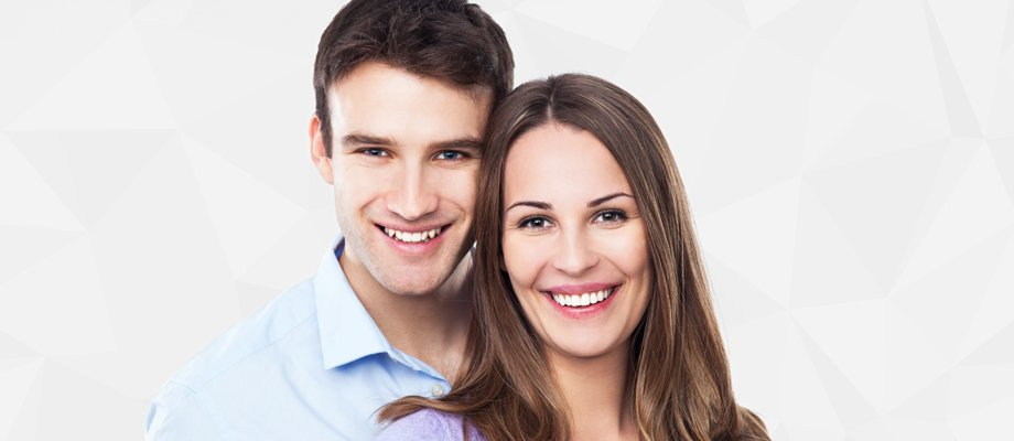 A smiling couple with healthy teeth