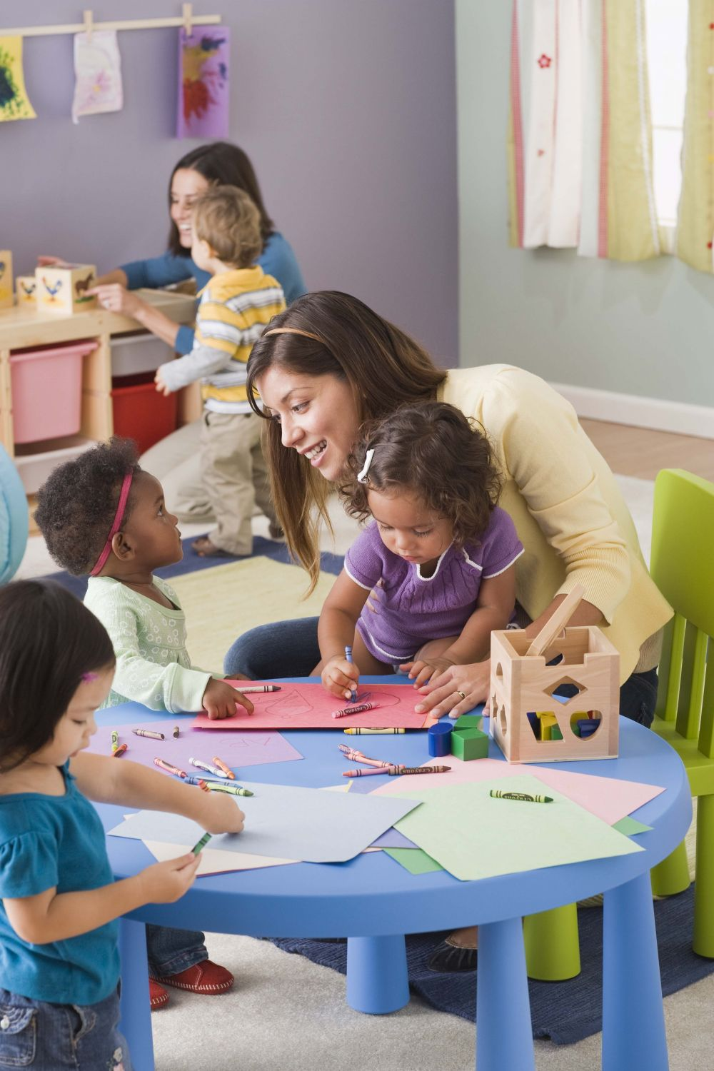 Teacher and children at our day care center in Lincoln, NE