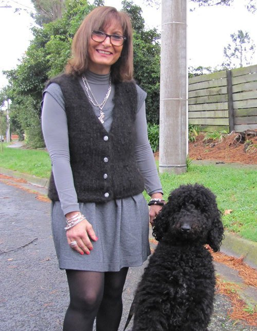 Customer wearing sweater made from her pet