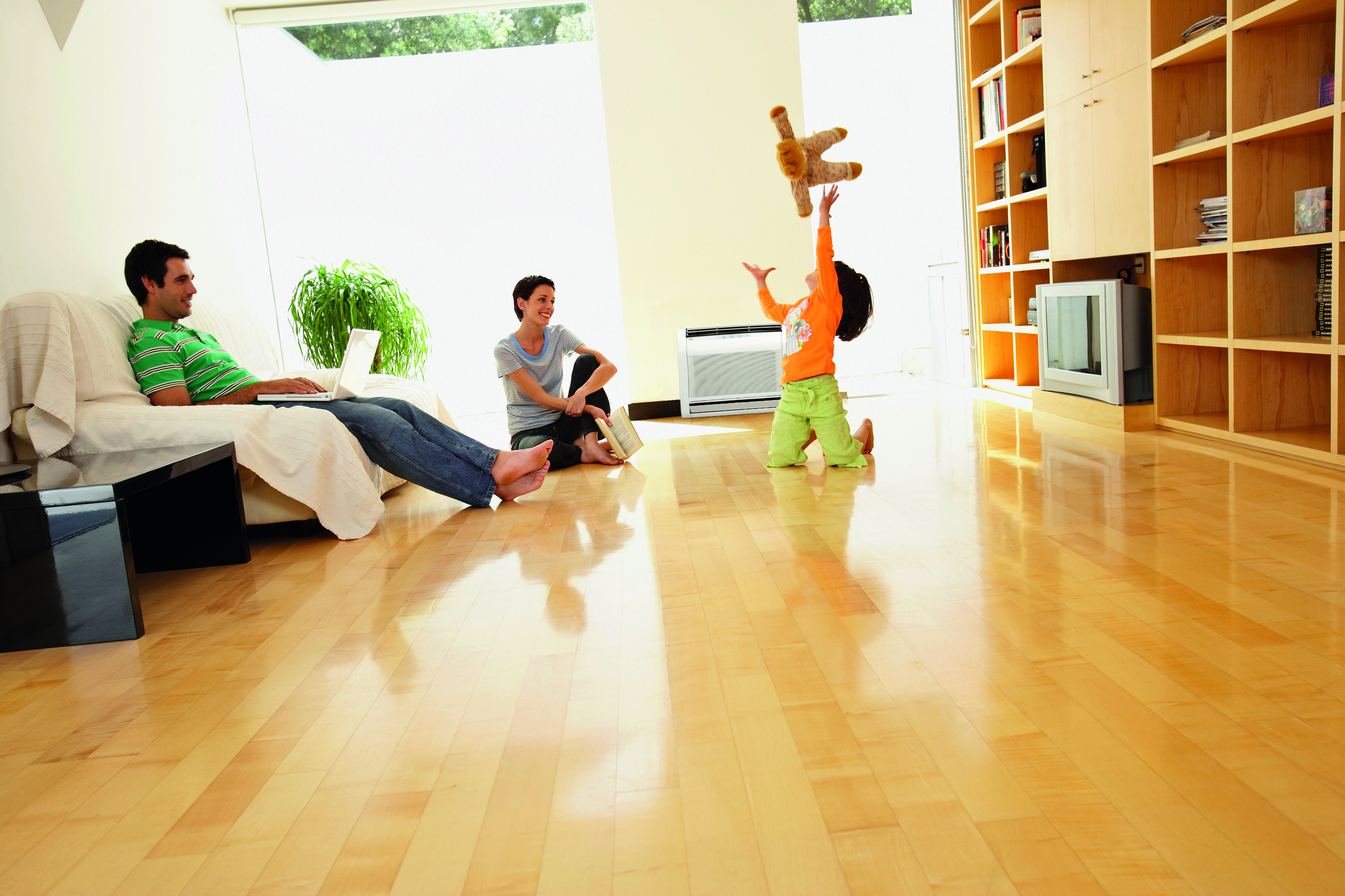 Children playing in the room with wooden surface