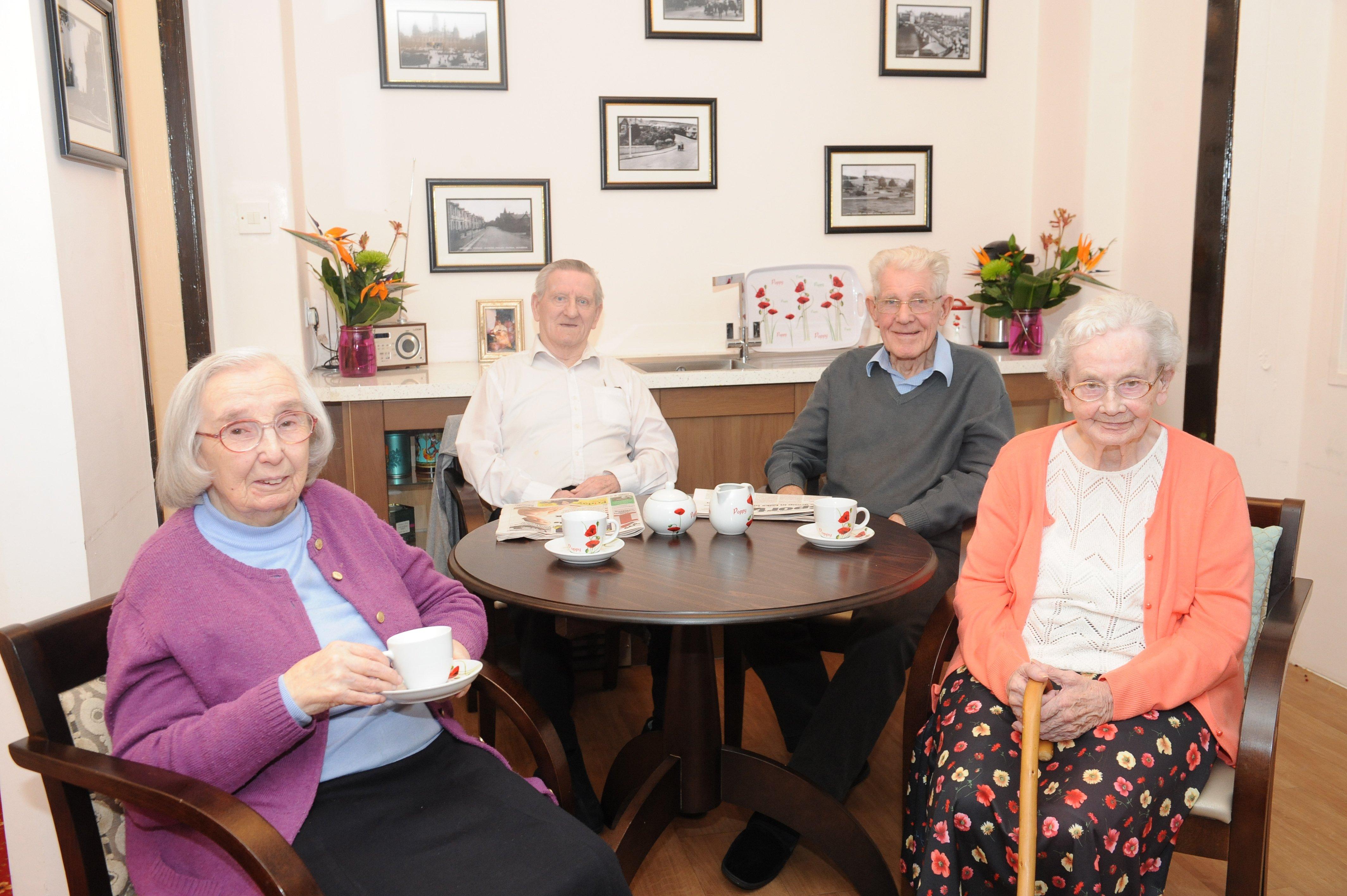 Senior persons having coffee