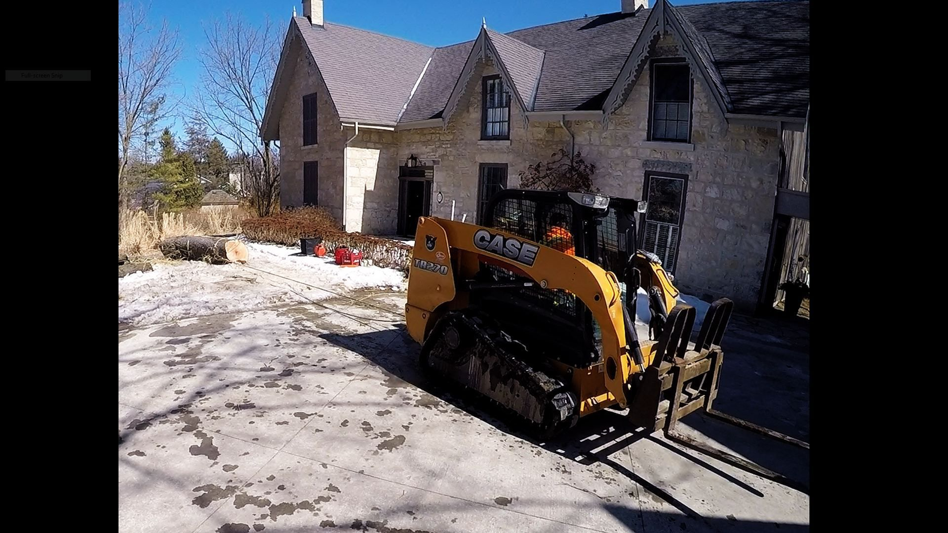 TR-270 Case skid steer at customers house.