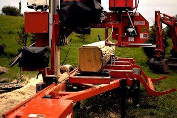 Getting log ready for rough sawn lumber.