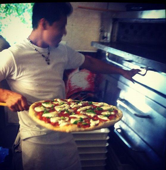 chef at pizzeria restaurant making pizza in Harriman, NY