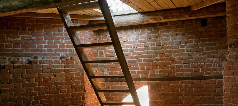 A ladder leading up to a loft