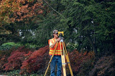 Land surveyor surveying a site in Cincinnati, OH