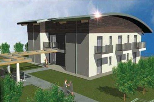 immagine in CAD di una casa con un giardino e una copertura in legno