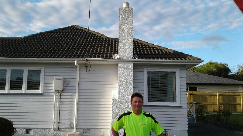 worker standing outside white chimney