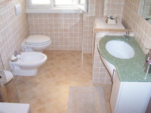 rifacimento pavimentazione e pareti bagno in cotto