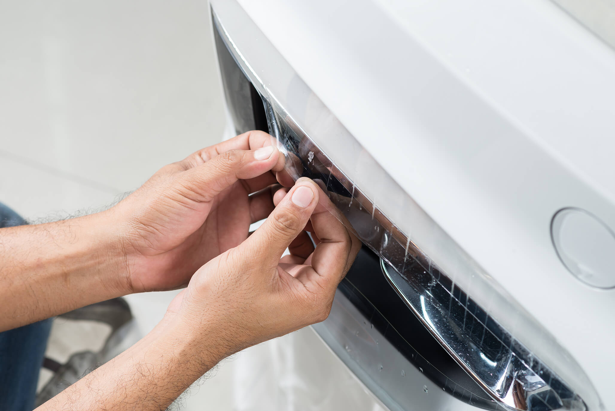 Protective film being applied on a car