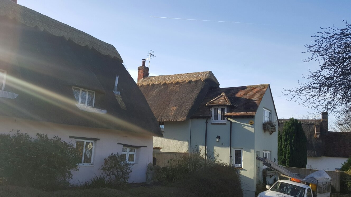 A property having its thatched roof repaired
