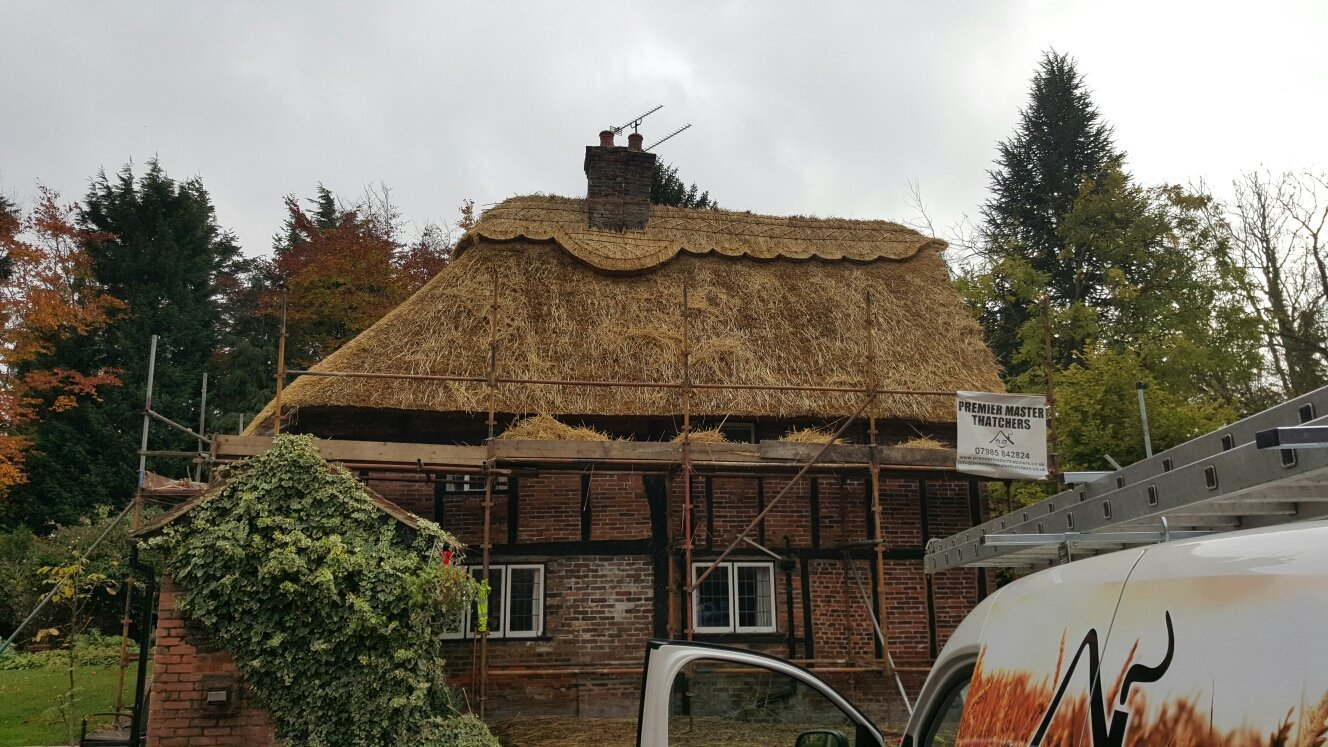 A thatched roof in the process of being re-thatched