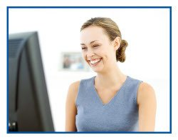 Lady smiling at computer screen featuring high speed internet service